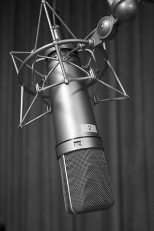 Black and white photograph of a Neumann U87 mi...